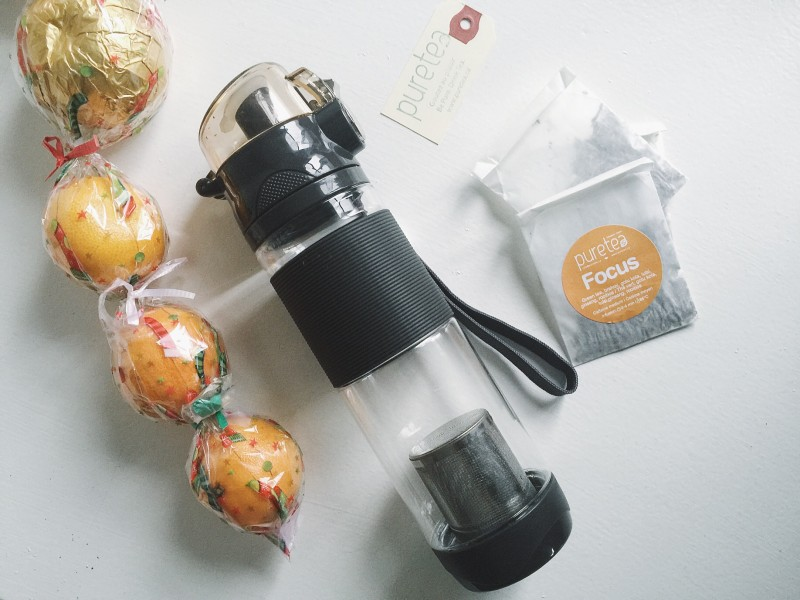 VSCOcam Puretea Tea Focus Christmas Oranges White background flatlay